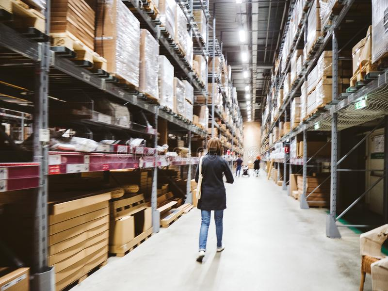 Woman shopping in ikea store warehouse stock image