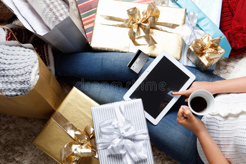Woman shopping online with a credit card. At Christmas royalty free stock photos