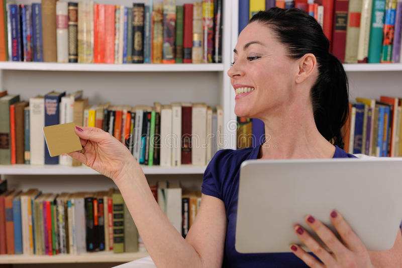 Woman shopping online with digital pad