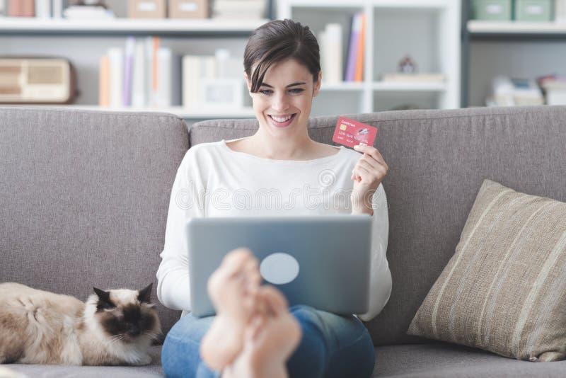 Woman shopping online stock photos