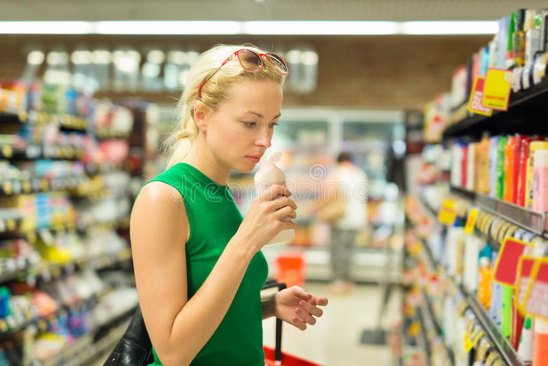 Woman shopping personal hygiene products at supermarket. Beautiful caucasian woman shopping personal hygiene products at supermarket stock photo