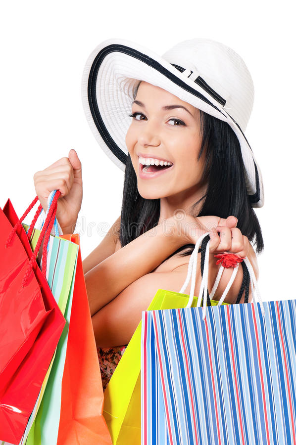Woman shopping. Portrait of young happy smiling woman with shopping bags, isolated over white background royalty free stock photography