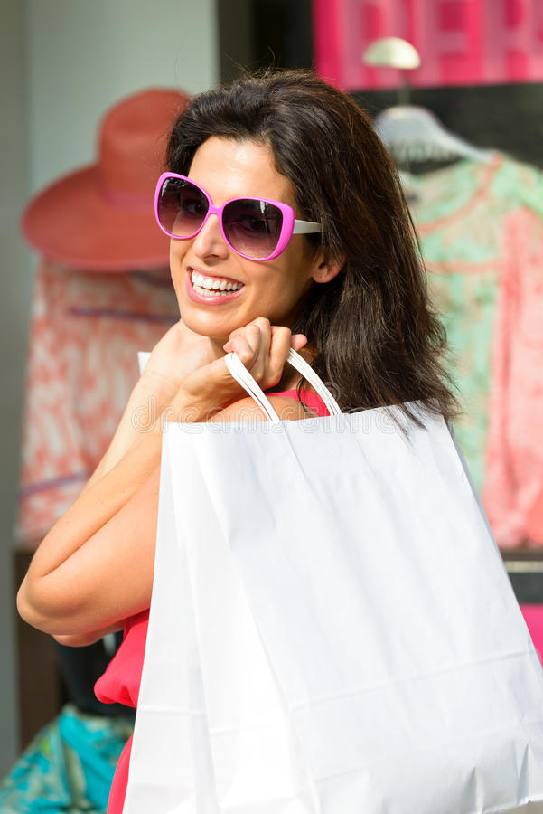 Woman shopping in the sales royalty free stock image