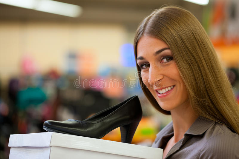 Download Woman Shopping Shoes In Store Stock Image - Image: 20446735
