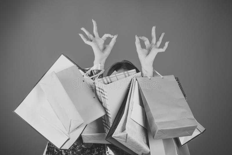 Woman shopping with shopping bag and ok hand sign. Good shopping experience concept stock photography
