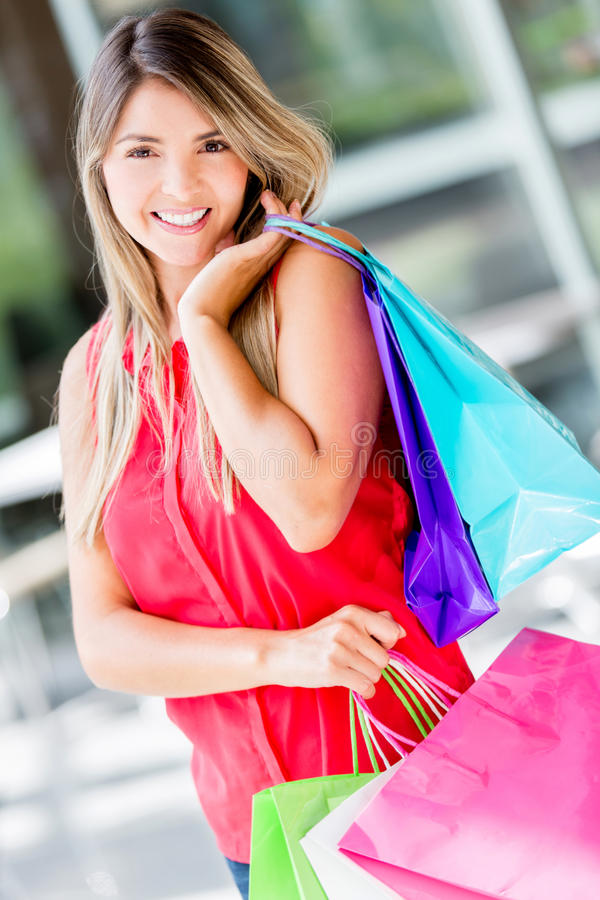 Download Woman on a shopping spree stock image. Image of customer - 28772883