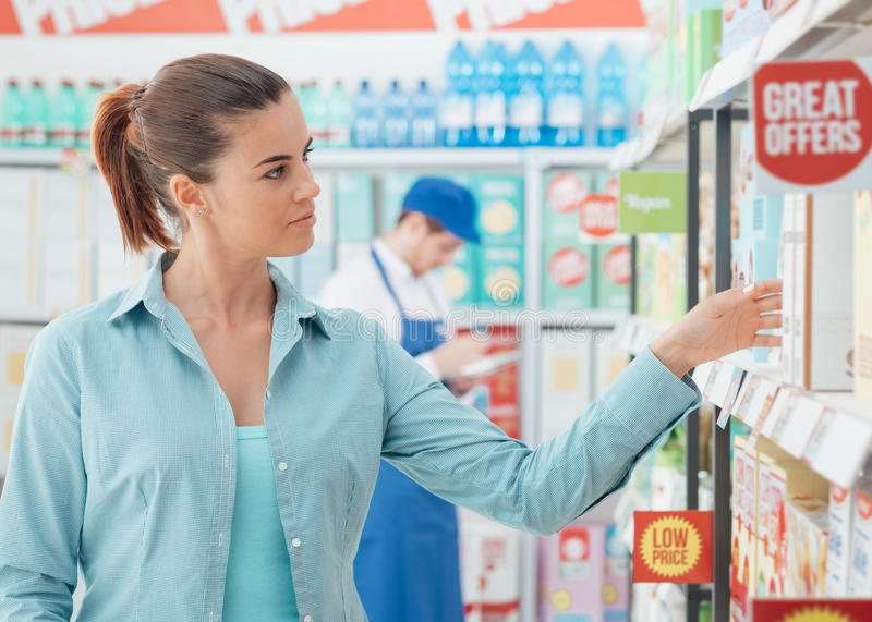Woman shopping at the store royalty free stock photography