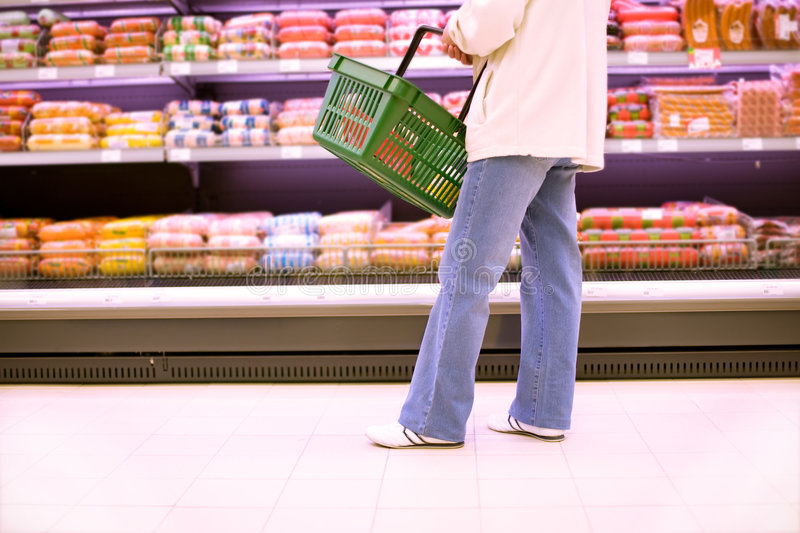 Woman shopping in a superstore royalty free stock photos