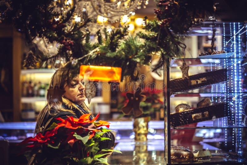 Woman shopping on traditional Christmas market stock photos