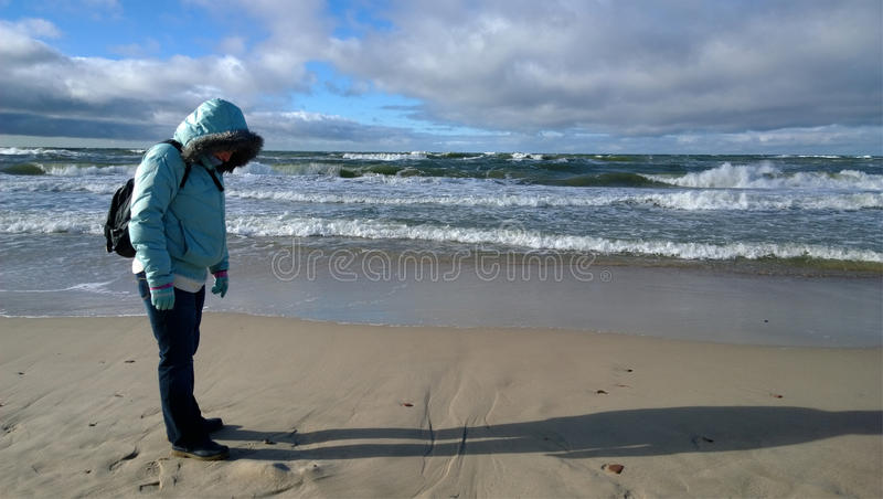 Woman on the shore of the Baltic sea stock photography
