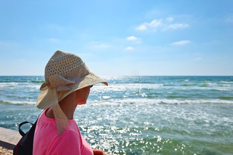 Woman on a shore of Mediterranean sea stock photo