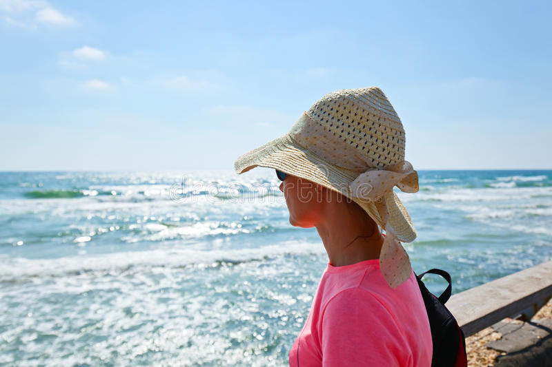 Woman on a shore of Mediterranean sea. Middle age woman on a shore of Mediterranean sea royalty free stock image