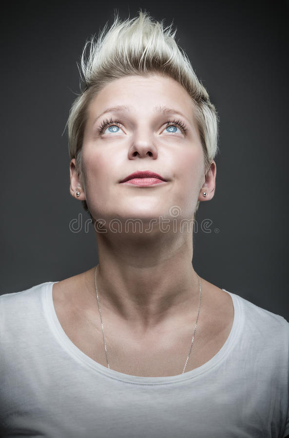 Woman with short blond hair. royalty free stock photos