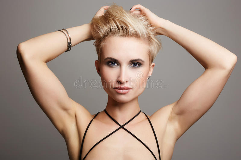 Woman with short hair.strong blonde girl stock photography