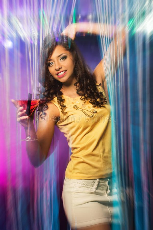 Woman in short skirt at the night club stock images