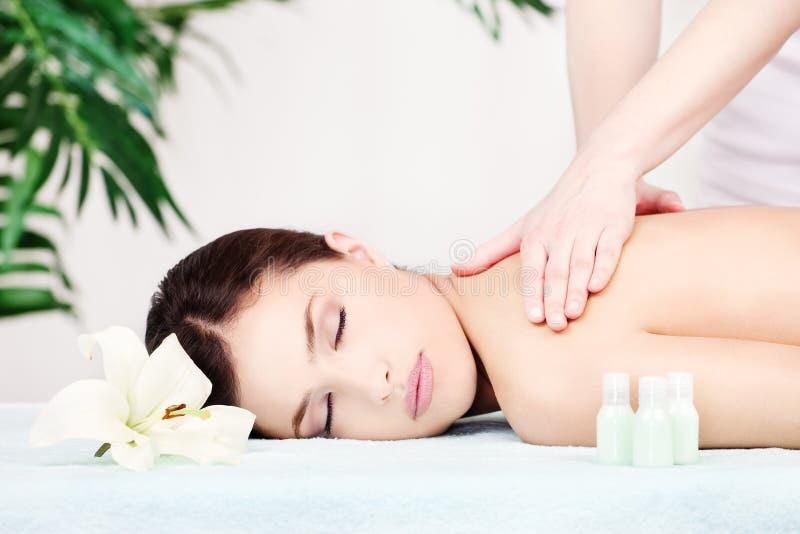 Woman on shoulder massage stock image