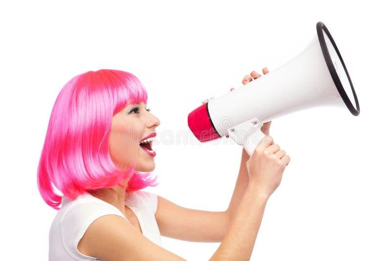Woman shouting through megaphone. Young woman shouting through megaphone stock photo