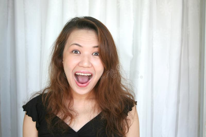 Woman shouting with suprized expression stock images