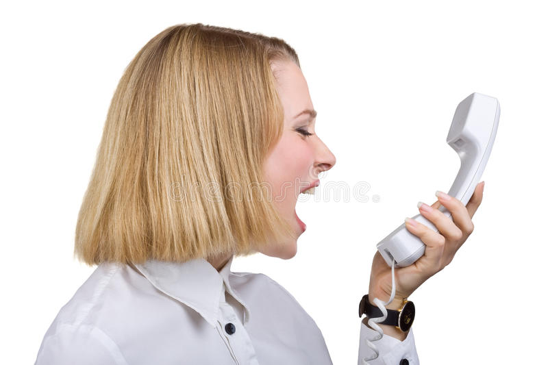 Woman shouting into the telephone receiver royalty free stock image