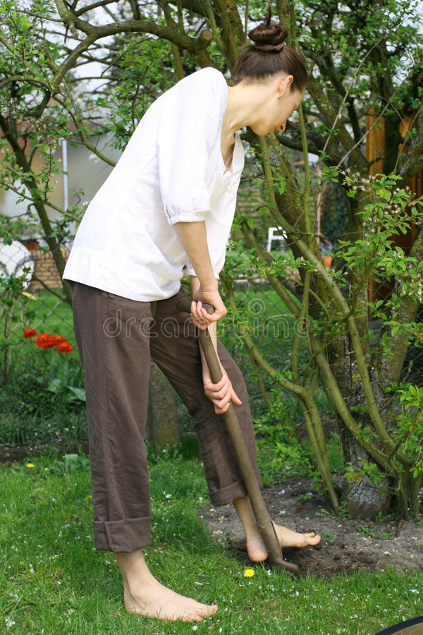 Woman with shovel royalty free stock images