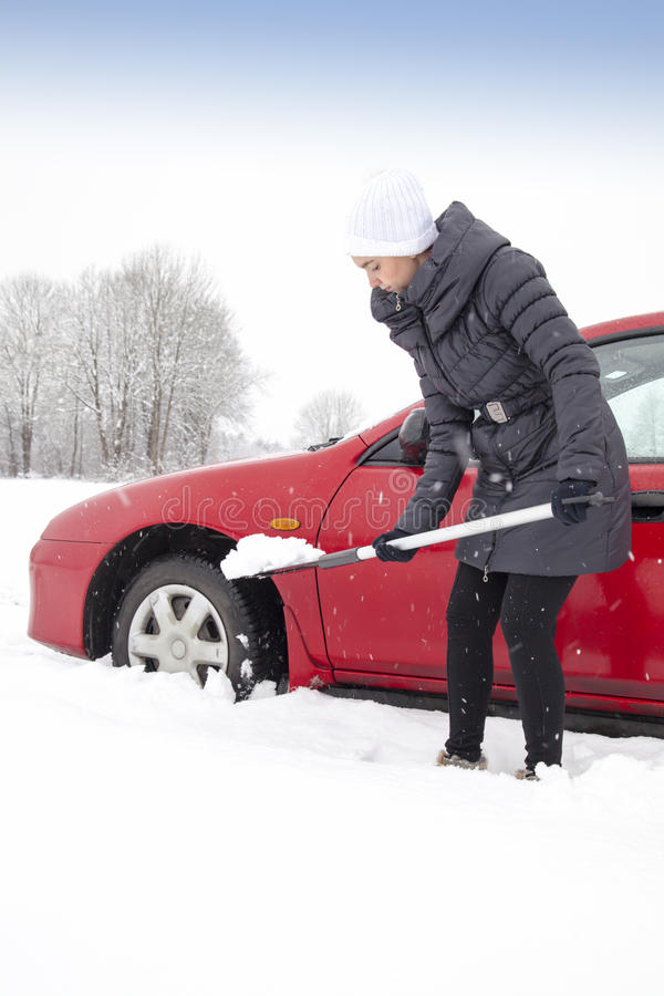 Woman shovelling and removing snow stock photos