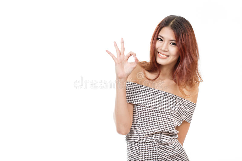 Woman show approval, agreement, accepting, positive hand sign stock photography