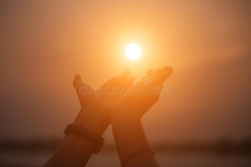 Woman show hands-shape for the Sun stock photo