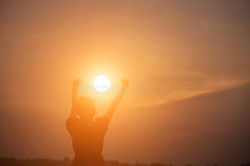 Woman show hands silhouette sunset background stock photo