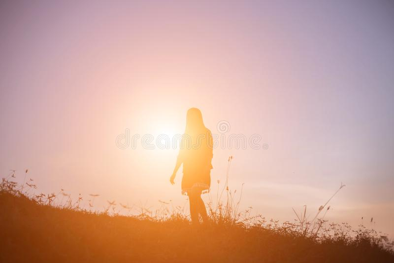 A cheerful woman run at the sun royalty free stock image