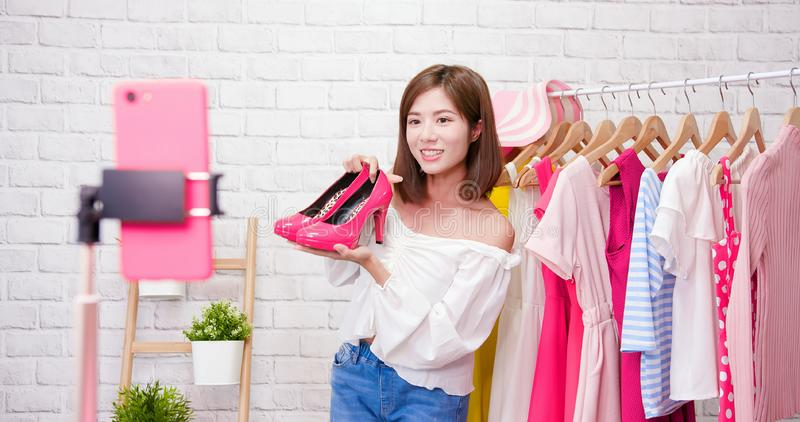 Woman show shoes in livestream stock images