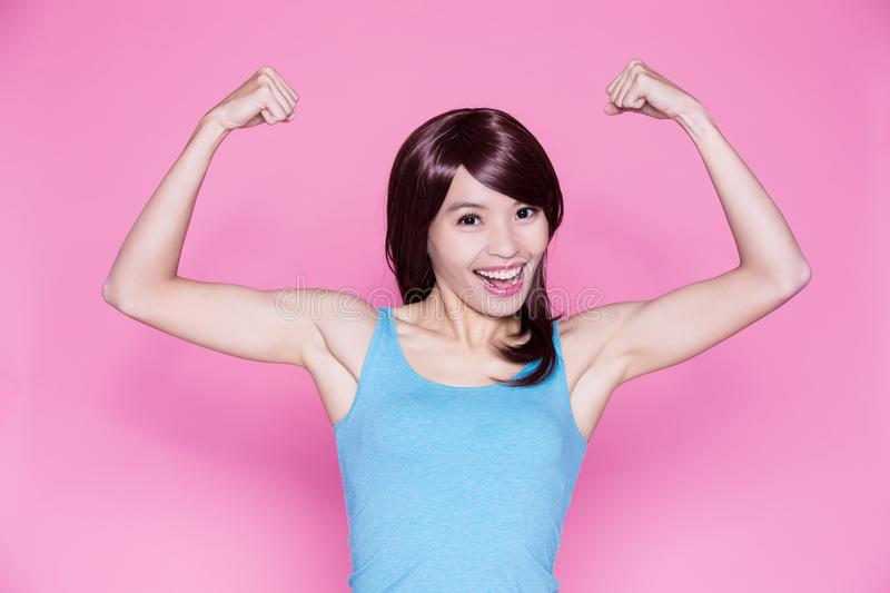 Woman show strong arm. To you on the pink background stock images