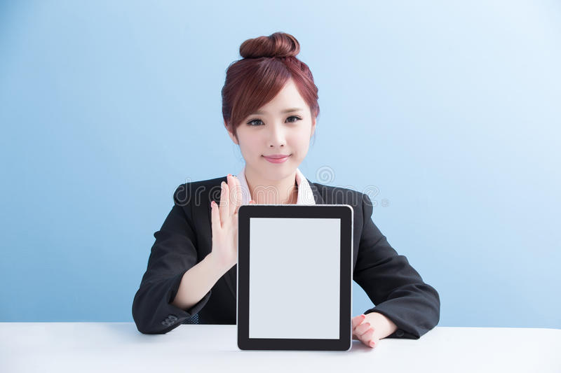Woman show tablet to you. Business woman show tablet to you with isolated on blue background, asian stock photos