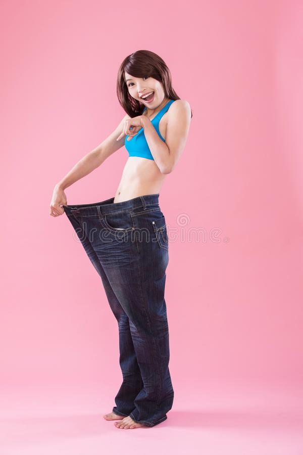 Woman show weight loss royalty free stock photo