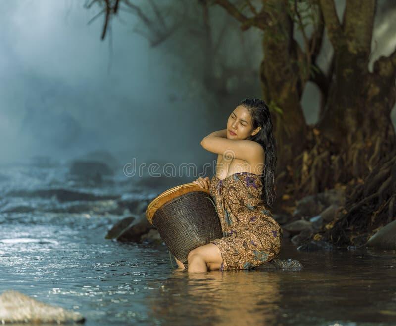 Woman showering in natural streams. Glamorous woman showering in natural streams stock photo