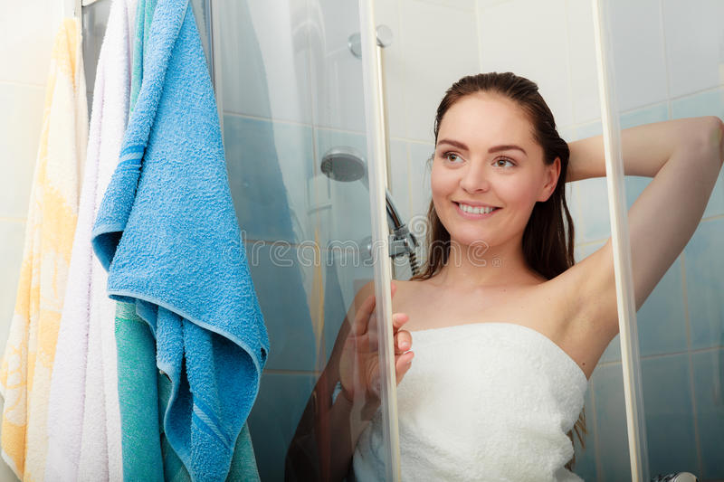 Woman showering in shower cabin cubicle. Girl showering in shower cabin enclosure. Woman taking care of hygiene in bathroom stock image
