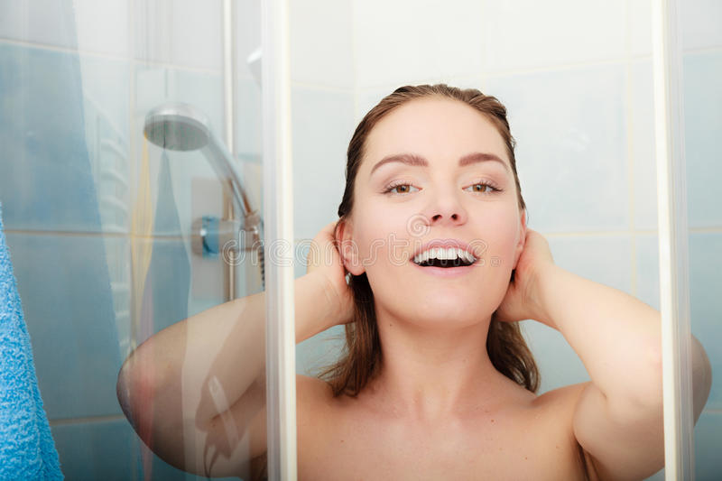 Woman showering in shower cabin cubicle. stock images