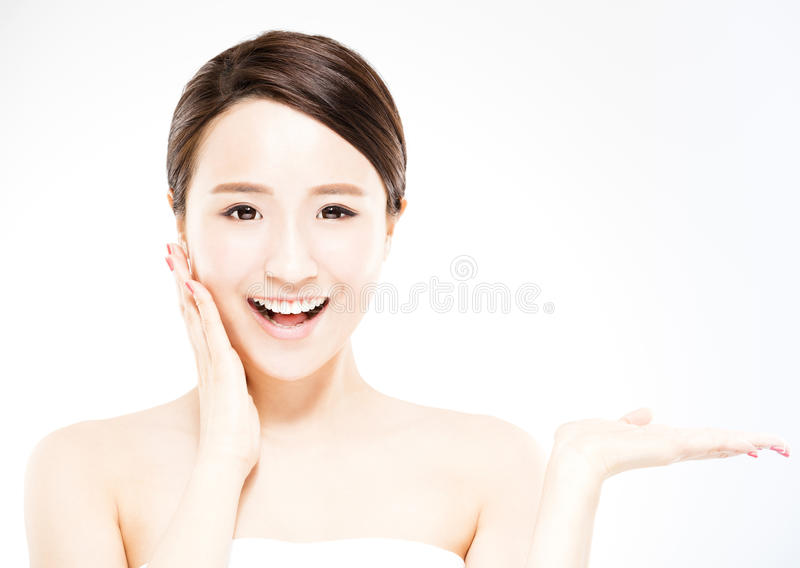 Woman showing beauty product on hand stock photos