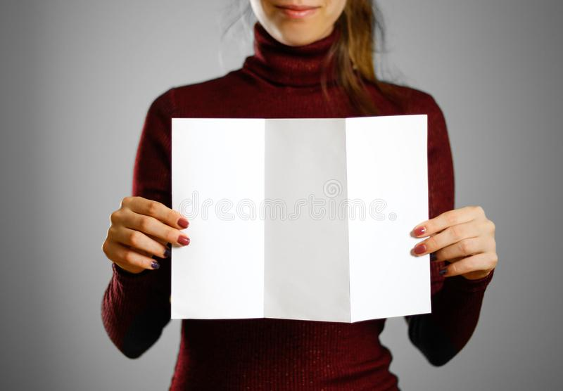 Woman showing blank white flyer paper. Leaflet presentation. Pam. Phlet hold hands. Girl show clear offset paper. Sheet template stock images