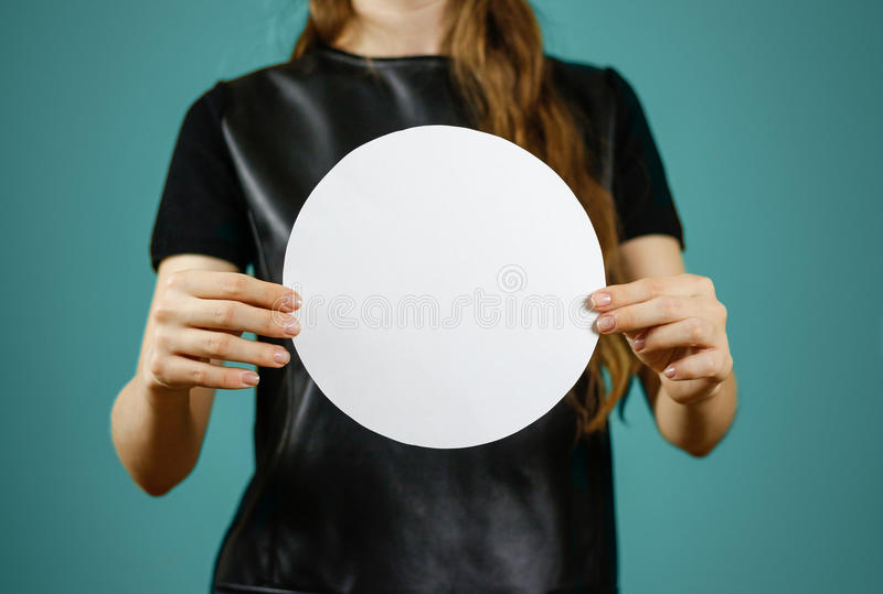 Woman showing blank white rounded flyer brochure booklet. Leaflet presentation. Pamphlet hold hands. Girl show clear offset paper. Sheet template. Booklet stock image