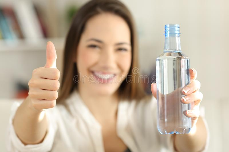Download Woman Showing A Bottle Of Water With Thumbs Up Stock Photo - Image of front, drink: 109159636