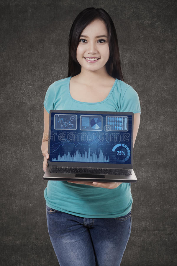 Woman showing business chart 2. Asian woman showing business chart on laptop royalty free stock image