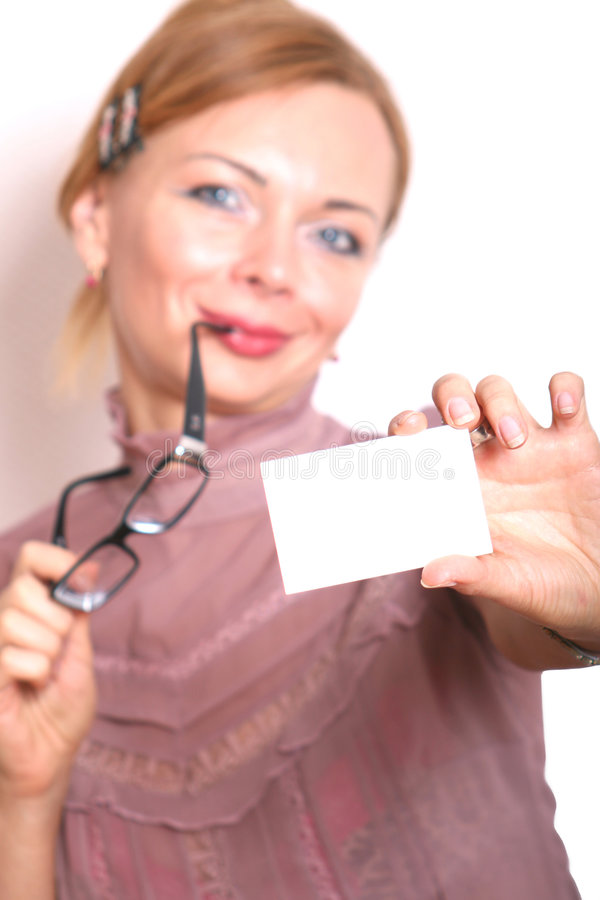 Woman showing a card royalty free stock photo
