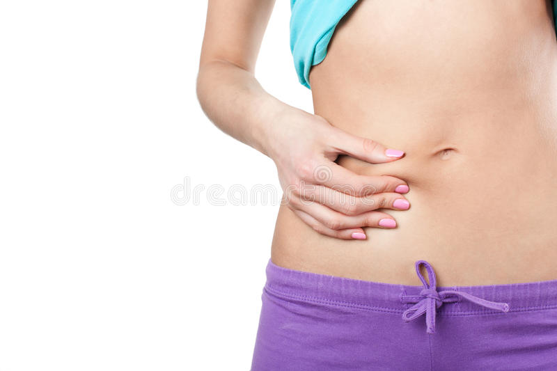Woman showing cellulite on her belly stock photography