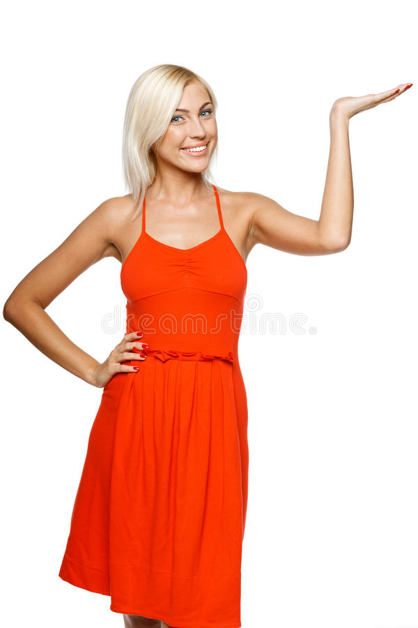 Woman showing copy space on her palm royalty free stock photos