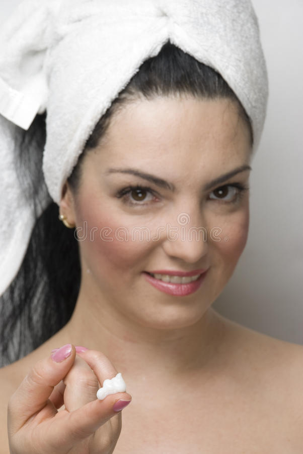Woman Showing Cream For Skin Care Stock Photos