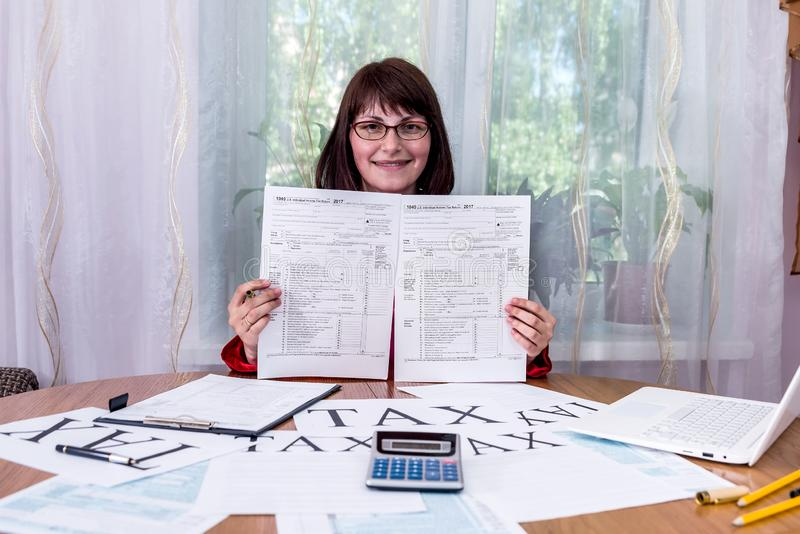 Woman showing empty blanks of 1040 tax. Form stock image