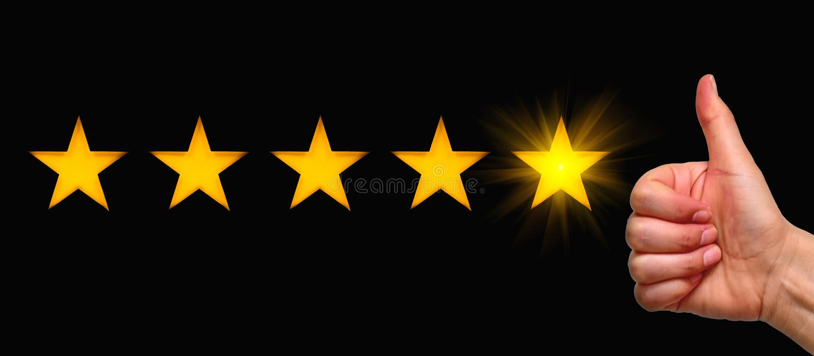 A woman showing hand sign thumb up and five star symbol, the concept of a positive rating, reviews and feedback. Black background stock photography