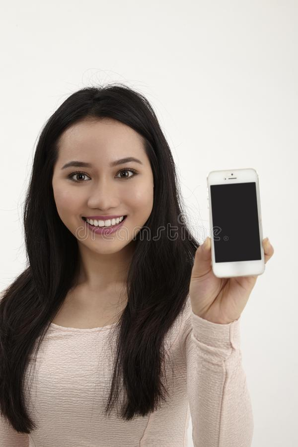 Woman showing her phone royalty free stock photo