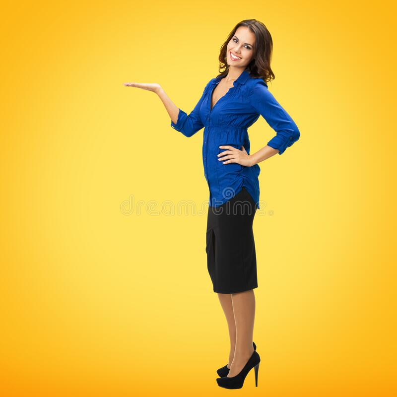 Woman showing, holding something, copy space royalty free stock photos
