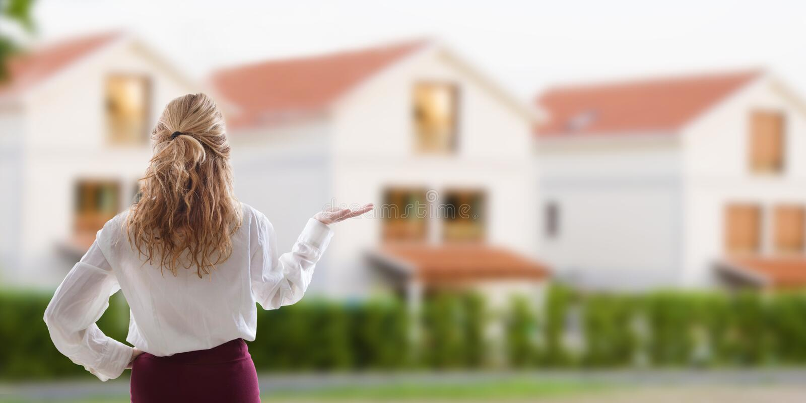 Woman showing the house for sale royalty free stock photo